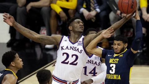 <p>               FILE - In this March 10, 2018, file photo, Kansas forward Silvio De Sousa (22) tips the ball away from West Virginia guard James Bolden (3) during the second half of an NCAA college basketball game in the finals of the Big 12 men's tournament, in Kansas City, Mo. Kansas forward Silvio De Sousa, whose name surfaced as part of the FBI's investigation into corruption in college basketball, will be withheld from competition pending a review of his eligibility. Jayhawks coach Bill Self said in a statement before appearing at the Big 12's annual media day Wednesday, Oct. 24,2018,  that the sophomore forward would be held out beginning with Thursday's exhibition game. (AP Photo/Orlin Wagner, File)             </p>
