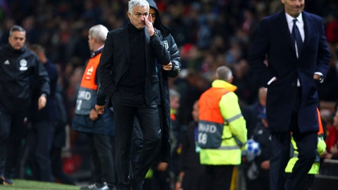 <p>               ManU coach Jose Mourinho, center, and Juventus coach Massimiliano Allegri, right, leave the field at the end of the Champions League group H soccer match between Manchester United and Juventus at Old Trafford, Manchester, England, Tuesday, Oct. 23, 2018. (AP Photo/Dave Thompson)             </p>