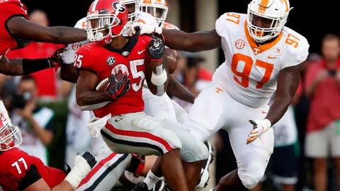 <p>               Georgia running back Brian Herrien (35) spins away from the grasp of Tennessee defensive lineman Paul Bain (97) during the second half of an NCAA college football game Saturday, Sept. 29, 2018, in Athens, Ga. Georgia won 38-12. (AP Photo/John Bazemore)             </p>
