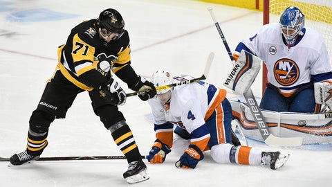 <p>               Pittsburgh Penguins center Evgeni Malkin (71) beats New York Islanders defenseman Thomas Hickey (4) and goaltender Thomas Greiss (1) during the third period of an NHL hockey game in Pittsburgh on Tuesday, Oct. 30, 2018, in Pittsburgh. The New York Islanders won 6-3. (AP Photo/Don Wright)             </p>