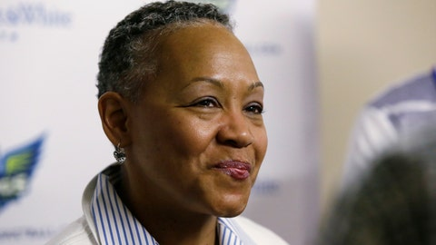 """<p>               FILE - In this May 21, 2016, file photo, WNBA President Lisa Borders smiles as she speaks to reporters before a WNBA basketball game between the San Antonio Stars and the Dallas Wings in Arlington, Texas. TIME'S UP has named Borders as its first president and CEO. In a statement Tuesday, Oct. 2, 2018, the organization said Borders will lead the organization's efforts to """"ensure equal opportunity and protection for all working women."""" (AP Photo/LM Otero, File)             </p>"""