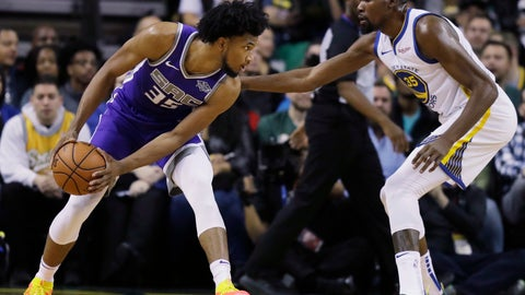 <p>               FILE - In this Friday, Oct. 5, 2018, file photo, Sacramento Kings forward Marvin Bagley III, left, is defended by Golden State Warriors forward Kevin Durant during the first half of an NBA basketball preseason game in Seattle. With a roster laden with young and mostly unproven players like De'Aaron Fox and Bagley, coupled with playing in a Western Conference that got even tougher with the arrival of LeBron James, Sacramento's focus is as much on development as it is instant success. (AP Photo/Ted S. Warren, File)             </p>