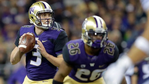 <p>               Washington quarterback Jake Browning looks to pass behind running back Salvon Ahmed during the second half of an NCAA college football game against BYU, Saturday, Sept. 29, 2018, in Seattle. (AP Photo/Ted S. Warren)             </p>