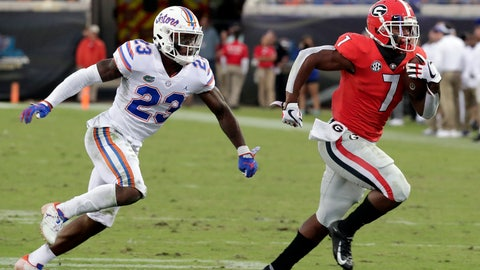 <p>               Georgia running back D'Andre Swift (7) runs past Florida defensive back Chauncey Gardner-Johnson (23) for a 33-yard touchdown during the second half of an NCAA college football game Saturday, Oct. 27, 2018, in Jacksonville, Fla. (AP Photo/John Raoux)             </p>
