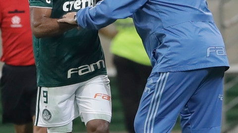 <p>               Miguel Borja of Brazil's Palmeiras celebrates with coach Luiz Felipe Scolari after scoring from the penalty spot his side's second goal against Chile's Colo Colo during a quarter final second leg Copa Libertadores soccer match in Sao Paulo, Brazil, Wednesday, Oct. 3, 2018. (AP Photo/Andre Penner)             </p>