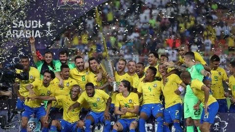 <p>               Brazil's Neymar holds the trophy as he celebrates with his teammates after the friendly soccer match between Brazil and Argentina at King Abdullah stadium in Jiddah, Saudi Arabia, Tuesday, Oct. 16, 2018. Brazil won 1-0. (AP Photo)             </p>