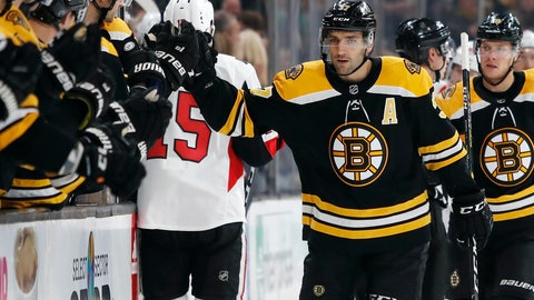 <p>               Boston Bruins' Patrice Bergeron is congratulated at the bench after scoring against the Ottawa Senators during the first period of an NHL hockey game Monday, Oct. 8, 2018, in Boston. (AP Photo/Winslow Townson)             </p>