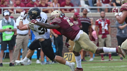 <p>               Wake Forest's Cade Carney tries to escape the tackle of Florida State's Dontavious Jackson in the second quarter of an NCAA college football game, Saturday, Oct. 20, 2018 in Tallahassee, Fla. Florida State won 38-17. (AP Photo/Steve Cannon)             </p>