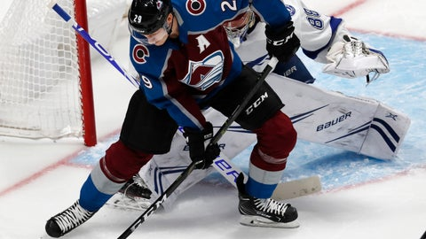 <p>               Colorado Avalanche center Nathan MacKinnon, front, tries to redirect the puck as Tampa Bay Lightning goaltender Andrei Vasilevskiy defends the net in the first period of an NHL hockey game, Wednesday, Oct. 24, 2018, in Denver. (AP Photo/David Zalubowski)             </p>
