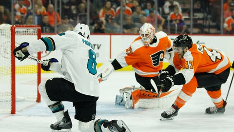 <p>               San Jose Sharks' Joe Pavelski (8), left, scores against Philadelphia Flyers' Brian Elliott, center, and Andrew MacDonald, right, during the first period an NHL hockey game Tuesday, Oct. 9, 2018, in Philadelphia. (AP Photo/Tom Mihalek)             </p>