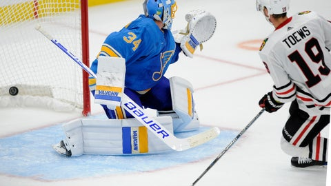 <p>               Chicago Blackhawks' Jonathan Toews (19) scores the game winning goal in overtime against St. Louis Blues' goalie Jake Allen (34) during an NHL hockey game, Saturday, Oct. 6, 2018, in St. Louis. (AP Photo/Bill Boyce)             </p>