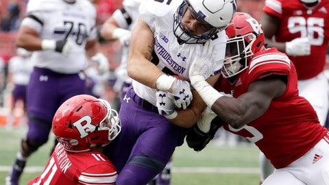 <p>               Northwestern running back Isaiah Bowser, center, is tackled by Rutgers defensive back Isaiah Wharton, left, and linebacker Trevor Morris during the first half of an NCAA college football game, Saturday, Oct. 20, 2018, in Piscataway, N.J. (AP Photo/Julio Cortez)             </p>
