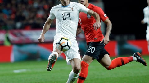 <p>               Uruguay's Edinson Cavani, left, fights for the ball against South Korea's Jang Hyun-soo during their friendly soccer match in Seoul, South Korea, Friday, Oct. 12, 2018. (AP Photo/Ahn Young-joon)             </p>