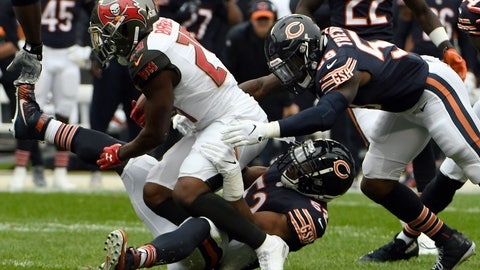 <p>               Chicago Bears linebacker Khalil Mack (52) tackles Tampa Bay Buccaneers running back Peyton Barber (25) as Chicago Bears linebacker Danny Trevathan (59) approaches them during the first half of an NFL football game Sunday, Sept. 30, 2018, in Chicago. (AP Photo/David Banks)             </p>