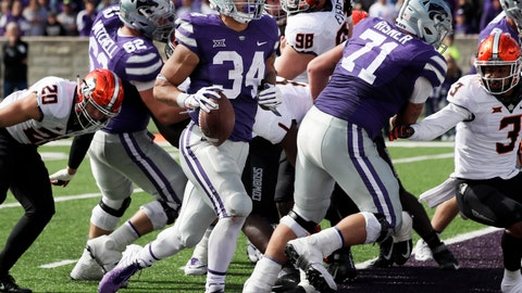 <p>               Kansas State running back Alex Barnes (34) scores a touchdown during the second half of an NCAA college football game against Oklahoma State in Manhattan, Kan., Saturday, Oct. 13, 2018. (AP Photo/Orlin Wagner)             </p>