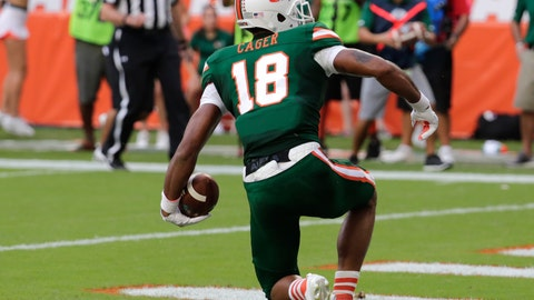 <p>               Miami wide receiver Lawrence Cager (18) scores a touchdown during the first half of an NCAA college football game against Florida State, Saturday, Oct. 6, 2018, in Miami Gardens, Fla. (AP Photo/Lynne Sladky)             </p>