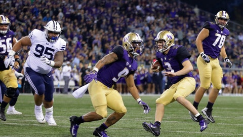 <p>               Washington quarterback Jake Browning (3) scrambles for a touchdown as offensive lineman Jared Hilbers (70) looks on during the first half of an NCAA college football game against Brigham Young, Saturday, Sept. 29, 2018, in Seattle. (AP Photo/Ted S. Warren)             </p>