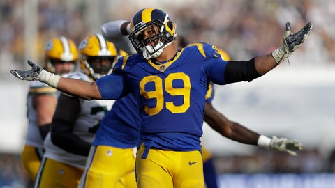 <p>               Los Angeles Rams defensive tackle Aaron Donald reacts after sacking Green Bay Packers quarterback Aaron Rodgers during the second half of an NFL football game, Sunday, Oct. 28, 2018, in Los Angeles. (AP Photo/Marcio Jose Sanchez)             </p>