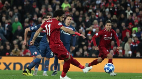Liverpool forward Mohamed Salah shoots and scores his sides 3rd goal from the penalty spot during the Champions League group C soccer match between Liverpool and Red Star at Anfield stadium in Liverpool England Wednesday Oct. 24,2018.(AP