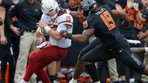 <p>               Oklahoma State linebacker Calvin Bundage (1), rear, pulls on the helmet of Iowa State quarterback Brock Purdy (15) during a tackle and is called for a penalty in the second half of an NCAA college football game in Stillwater, Okla., Saturday, Oct. 6, 2018. Oklahoma State linebacker Justin Phillips (19) is at right. (AP Photo/Sue Ogrocki)             </p>