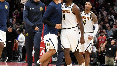 <p>               Denver Nuggets forward Paul Millsap (4) celebrates his go-ahead basket against the Chicago Bulls with his teammates during overtime of an NBA basketball game Wednesday, Oct. 31, 2018, in Chicago.The Nuggets won 108-107. (AP Photo/David Banks)             </p>