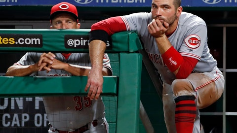 <p>               FILE - In this Sept. 5, 2018, file photo, Cincinnati Reds' Joey Votto, right, stands on the dugout steps next to interim manager Jim Riggleman during the fifth inning of a baseball game against the Pittsburgh Pirates, in Pittsburgh. The Reds lost 90 games for the fourth straight season and headed into the offseason unsure who will manage next year. (AP Photo/Gene J. Puskar, File)             </p>