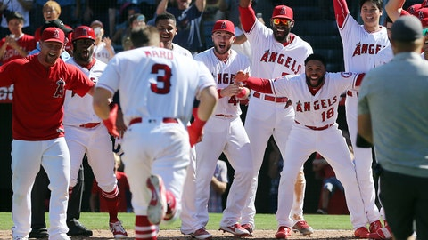 <p>               Los Angeles Angels teammates welcome Taylor Ward to home plate on his two-run home run, driving in Shoehi Ohtani, right rear, that gave the Angels a 5-4 walk-off win over the Oakland Athletics in the ninth inning of a baseball game in Anaheim, Calif., Sunday, Sept. 30, 2018. (AP Photo/Reed Saxon)             </p>