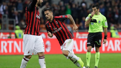 <p>               AC Milan's Suso celebrates past his teammate Gonzalo Higuain, left, after scoring his side's third goal during the Serie A soccer match between AC Milan and Sampdoria, at the San Siro stadium in Milan, Italy, Sunday, Oct. 28, 2018. (AP Photo/Luca Bruno)             </p>