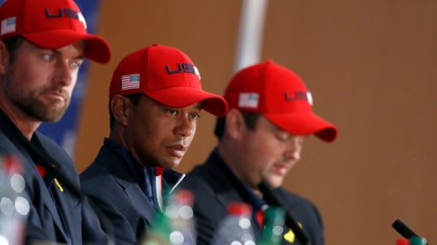 <p>               US players Webb Simpson, left, Tiger Woods and Patrick Reed, right, attend the press conference of the losing team after Europe won the 2018 Ryder Cup golf tournament at Le Golf National in Saint Quentin-en-Yvelines, outside Paris, France, Sunday, Sept. 30, 2018. (AP Photo/Alastair Grant)             </p>