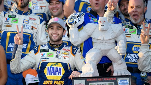 <p>               Chase Elliott, front left, poses with the trophy in Victory Lane after he won a NASCAR Cup Series auto race, Sunday, Oct. 7, 2018, at Dover International Speedway in Dover, Del. (AP Photo/Nick Wass)             </p>