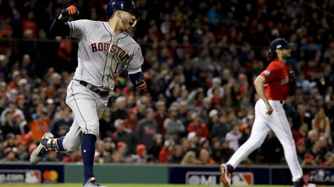<p>               Houston Astros' Carlos Correa celebrates after his RBI-single against the Boston Red Sox during the sixth inning in Game 1 of a baseball American League Championship Series on Saturday, Oct. 13, 2018, in Boston. (AP Photo/David J. Phillip)             </p>