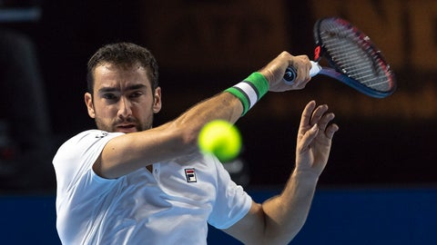 <p>               Croatia's Marin Cilic returns a ball to Canada's Denis Shapovalov during their first round match at the Swiss Indoors tennis tournament at the St. Jakobshalle in Basel, Switzerland, on Monday, Oct. 22, 2018. (Georgios Kefalas/Keystone via AP)             </p>