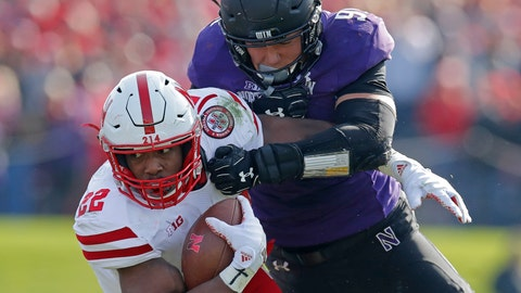 <p>               FILE - In this Saturday, Oct. 13, 2018, file photo, Nebraska's Devine Ozigbo, left, is tackled by Northwestern's Samdup Miller during the second half of an NCAA college football game in Evanston, Ill. If Nebraska needs any extra incentive to pick up its elusive first win Saturday, players who were on the field against Minnesota last year need only remember what happened in that game. (AP Photo/Jim Young, File)             </p>