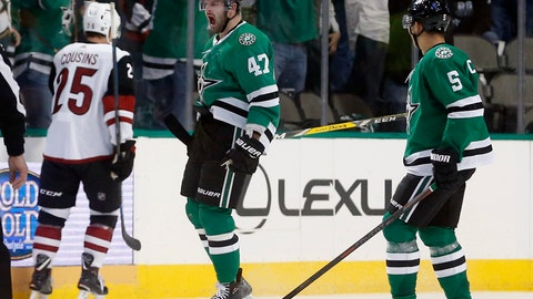 <p>               Dallas Stars right wing Alexander Radulov (47) celebrates his goal with defenseman Connor Carrick (5) as Arizona Coyotes center Nick Cousins (25) skates away during the second period of an NHL hockey game in Dallas, Thursday, Oct. 4, 2018. (AP Photo/Michael Ainsworth)             </p>