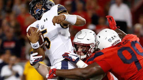 <p>               Arizona linebacker Colin Schooler (7) and defensive tackle Dereck Boles (99) tackle California quarterback Brandon McIlwain (5) during the first half of an NCAA college football game Saturday, Oct. 6, 2018, in Tucson, Ariz. (AP Photo/Chris Coduto)             </p>