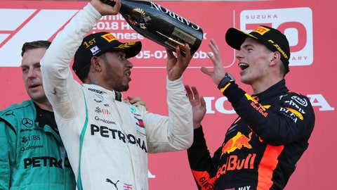 <p>               Race winner Mercedes driver Lewis Hamilton prepares to pour champagne on third placed Red Bull Racing driver Max Verstappen, left, as they celebrate on the podium at the Japanese Formula One Grand Prix at the Suzuka Circuit in Suzuka, central Japan, Sunday, Oct. 7, 2018. (AP Photo/Ng Han Guan)             </p>