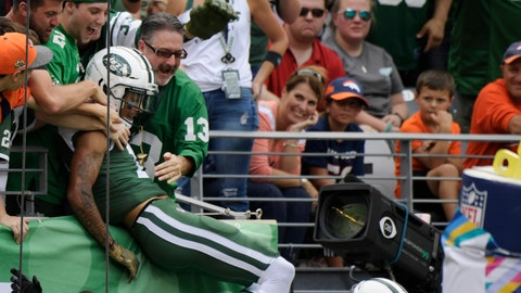 <p>               New York Jets' Robby Anderson (11) celebrates with fans after scoring a touchdown during the first half of an NFL football game against the Denver Broncos Sunday, Oct. 7, 2018, in East Rutherford, N.J. (AP Photo/Bill Kostroun)             </p>
