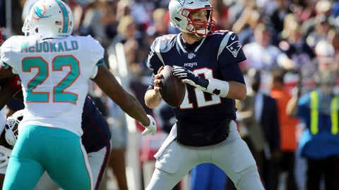 <p>               New England Patriots quarterback Tom Brady (12) looks for a receiver under pressure from Miami Dolphins defensive back T.J. McDonald (22) during the first half of an NFL football game, Sunday, Sept. 30, 2018, in Foxborough, Mass. (AP Photo/Elise Amendola)             </p>