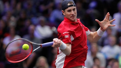 <p>               FILE - In this Sunday, Sept. 23, 2018 file photo, Team World's John Isner plays Team Europe's Roger Federer during a men's singles tennis match at the Laver Cup, in Chicago. John Isner was taken all the way by fellow American Bradley Klahn before winning his first match of the week at the Stockholm Open on Thursday, Oct. 18. The top-seeded Isner toughed out a 7-6 (2), 6-7 (5), 7-6 (5) win in the second round after receiving a bye in the first round. (AP Photo/Jim Young, file)             </p>