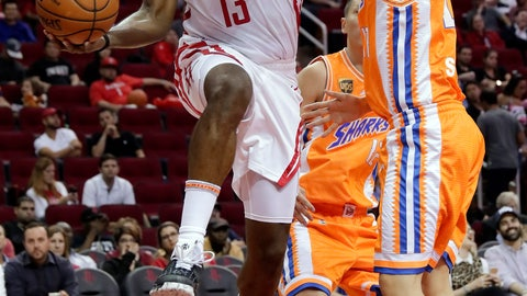 <p>               Houston Rockets guard James Harden (13) passes the ball around Shanghai Sharks guard Shi Yuchen (47) during the second half of an exhibition NBA basketball game Tuesday, Oct. 9, 2018, in Houston. (AP Photo/Michael Wyke)             </p>