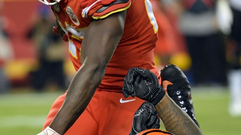 <p>               Kansas City Chiefs running back Kareem Hunt (27) pushes off a tackle attempt by Cincinnati Bengals linebacker Vontaze Burfict (55) during the second half of an NFL football game in Kansas City, Mo., Sunday, Oct. 21, 2018. The Chiefs won, 45-10. (AP Photo/Reed Hoffmann)             </p>