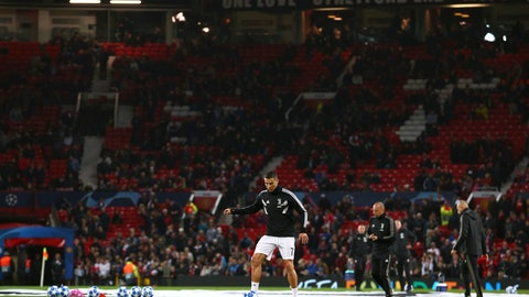 <p>               Juventus forward Cristiano Ronaldo kicks a ball during warmup before the Champions League group H soccer match between Manchester United and Juventus at Old Trafford, Manchester, England, Tuesday, Oct. 23, 2018. (AP Photo/Dave Thompson)             </p>