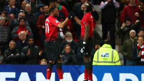 <p>               Manchester United's Anthony Martial celebrates with Paul Pogba, right, after scoring his side's second goal during the English Premier League soccer match between Manchester United and Everton FC at Old Trafford in Manchester, England, Sunday Oct. 28, 2018. (AP Photo/Dave Thompson)             </p>