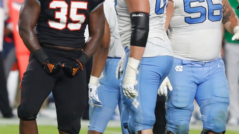 <p>               Miami linebacker Mike Smith (35) celebrates after stopping North Carolina running back Jordon Brown during the second half of an NCAA college football game Thursday, Sept. 27, 2018, in Miami Gardens, Fla. Miami defeated North Carolina 47-10. (AP Photo/Wilfredo Lee)             </p>