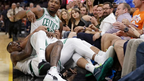<p>               Boston Celtics' Marcus Smart is held back by teammates during a scuffle in the first half of an NBA preseason basketball game against the Cleveland Cavaliers, Saturday, Oct. 6, 2018, in Cleveland. Smart was ejected from the game. (AP Photo/Tony Dejak)             </p>