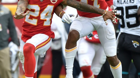 <p>               Kansas City Chiefs defensive back Jordan Lucas (24) celebrates with wide receiver Demarcus Robinson (11) after a tackle of Jacksonville Jaguars tight end Niles Paul during the first half of an NFL football game in Kansas City, Mo., Sunday, Oct. 7, 2018. (AP Photo/Ed Zurga)             </p>