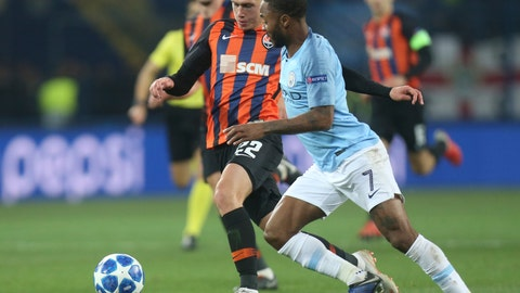<p>               Manchester City Raheem Sterling, right, and Shakhtar Mykola Matviyenko challenge for the ball during the Group F Champions League soccer match between FC Shakhtar Donetsk and Manchester City at the Metalist Stadium in Kharkiv, Ukraine, Tuesday, Oct. 23, 2018. (AP Photo/Efrem Lukatsky)             </p>