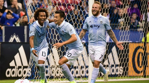 Oct 17, 2018; Vancouver, British Columbia, CAN; Sporting KC midfielder Gianluca Busio (13) celebrates with forward Daniel Salloi (20) and forward Johnny Russell (7) after scoring a goal against Vancouver Whitecaps goalkeeper Stefan Marinovic (not pictured) during the second half at BC Place. Mandatory Credit: Anne-Marie Sorvin-USA TODAY Sports
