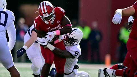 Oct 20, 2018; Bloomington, IN, USA; Indiana Hoosiers running back Stevie Scott (21) is tackled by Penn State Nittany Lions linebacker Cam Brown (6) during the first quarter of the game at Memorial Stadium . Mandatory Credit: Marc Lebryk-USA TODAY Sports