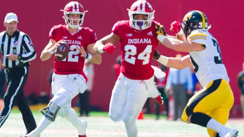 Indiana Hoosiers quarterback Peyton Ramsey (12) looks up field for an open receiver during the first half of an NCAA college football game against Iowa, Saturday, Oct. 13, 2018, in Bloomington, Ind. (AP Photo/Doug McSchooler)